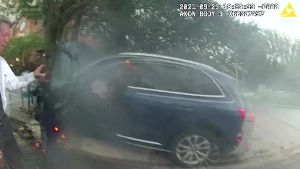 VIDEO: Off-duty police officer pulls driver from burning car after crash