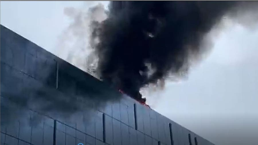 Fire at southwest DC high-rise building sends smoke plume into air, video shows