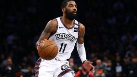 Nets' Kyrie Irving won't play with team until he is 'eligible to be a full participant'