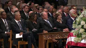 Bush slips Michelle Obama candy