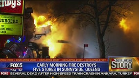Fire rips through several stores in Queens