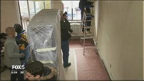 Volunteers rebuild neighbors' homes