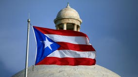 Puerto Rico to open vaccinations to all amid coronavirus spike
