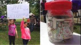 Girl opens lemonade stand to save library