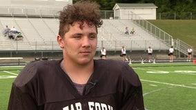 High school football player lifts car off of neighbor, saving his life