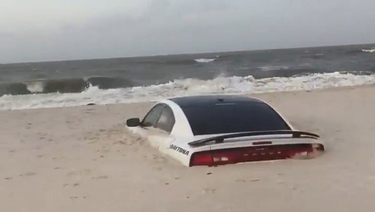 d06af7ed-car buried in sand_1563187772337.jpg-401385.jpg