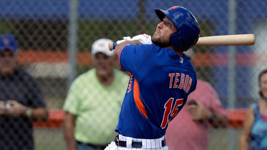 Tim Tebow hitting a home run