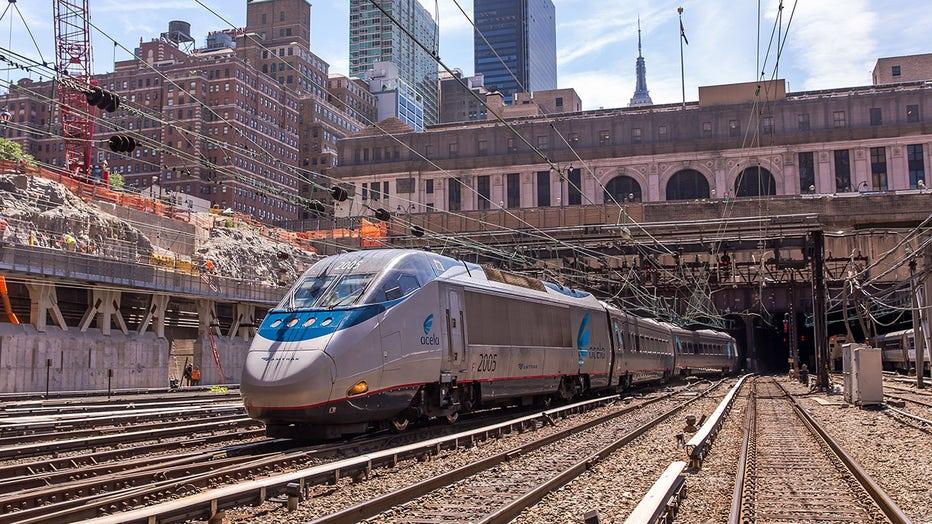 Amtrak train emerging from a Penn Station tunnel