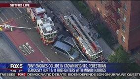 Fire trucks collide injuring pedestrian, firefighters