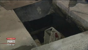 Woman rescued after plunging into pit on Manhattan sidewalk