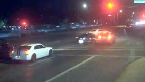 Caught on cam: Car crashes into suspected drunk driver running red light, possibly saving couple's lives