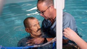 Wheelchair-bound Alabama man who is dying of cancer gets baptized as final request