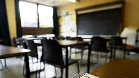 Teacher accused of placing students with handicaps into trash cans