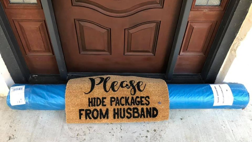 UPS driver 'hides' large package under doormat