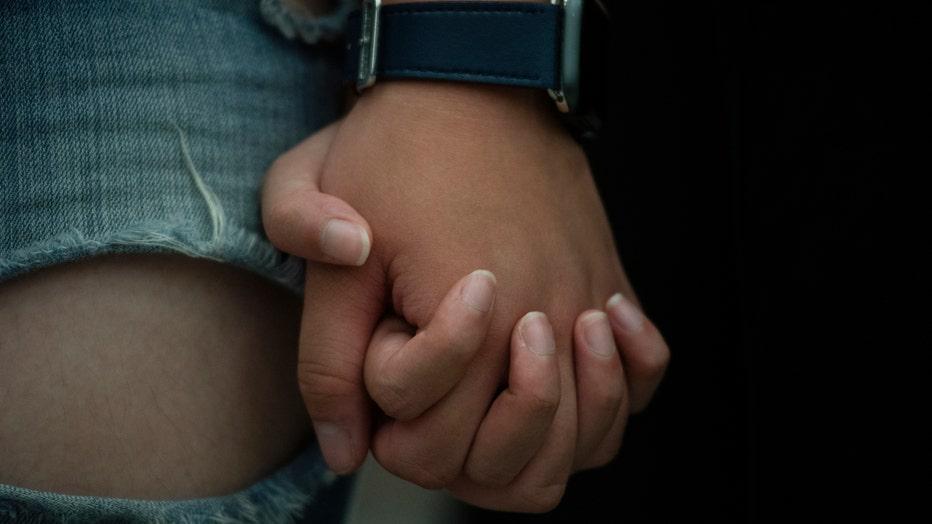 holding-hands-getty-1.jpg