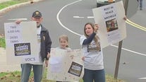 Families protest outside a school they say is making people sick