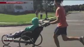 Teacher and paralyzed former student cross New York City Marathon finish line as a team