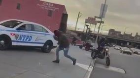 Dirt bikes surround cop