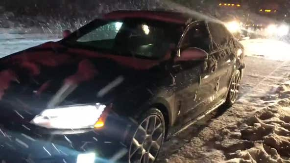Couple celebrate Thanksgiving while stranded on road by winter storm