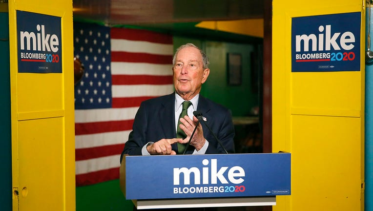 Mike Bloomberg speaks from behind a lecturn