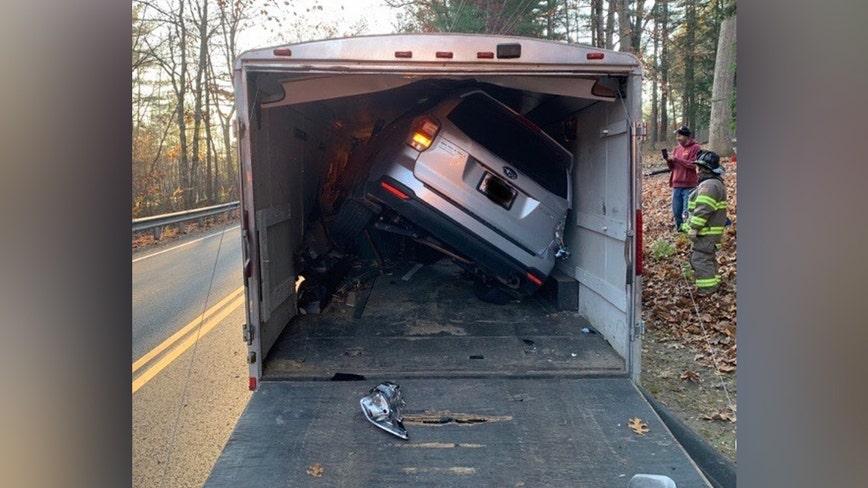 Massachusetts driver crashes SUV into trailer literally