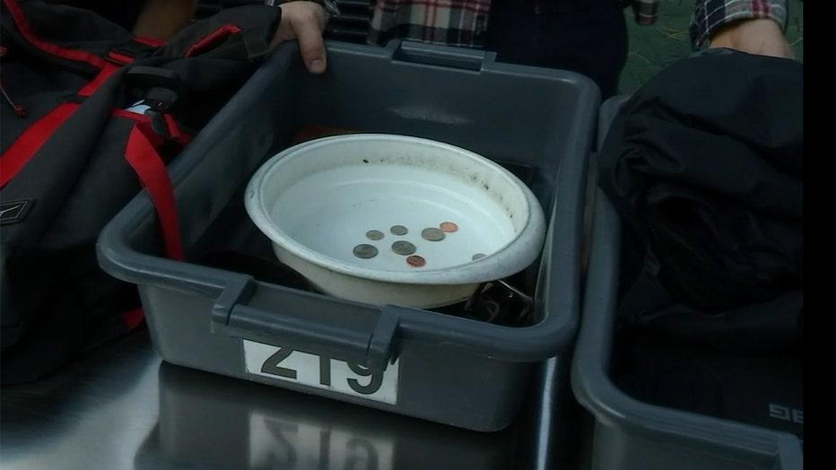 Coins inside a TSA bin