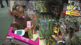 Nassau police take over 100 homeless children on Christmas shopping spree