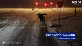 Storm winds toss tourist around icy pavement in Iceland