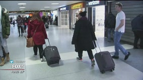 Millions hit the road, rail and skies to travel for Christmas