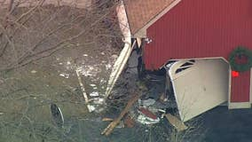 Vehicle crashes into NJ house