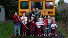 'Grandfather Express': Man surprises grandchildren with bus to take them to school each morning