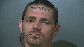 Indiana suspect with 'Crime Pays' face tattoo remains at large: police