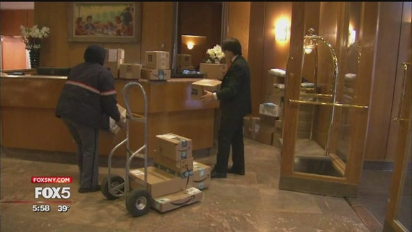 Holiday shipping rush keeps NYC doormen working hard for the holidays
