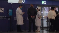 City in China stops outbound flights, trains to fight virus