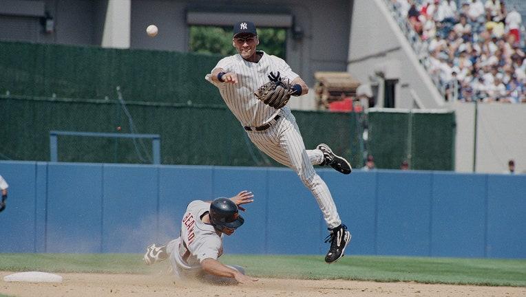 New York Yankees shortstop Derek Jeter throws to first base during a game at Yankee Stadium in New York, July 22, 1998.