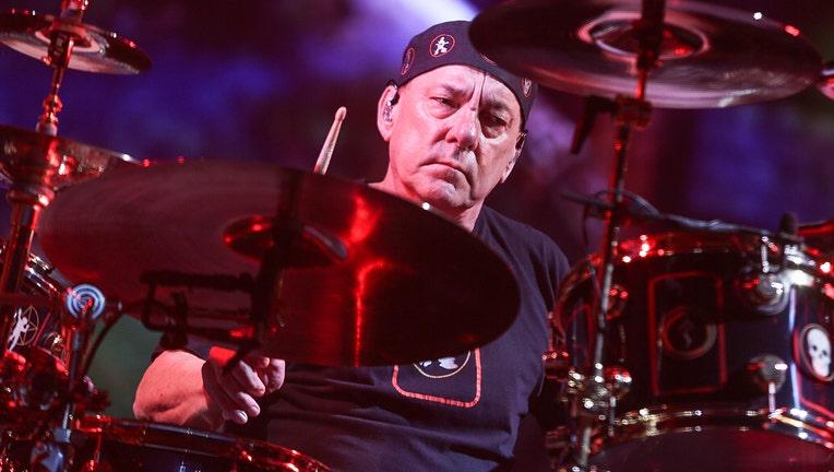 Drummer Neil Peart of Rush behind his drum kit
