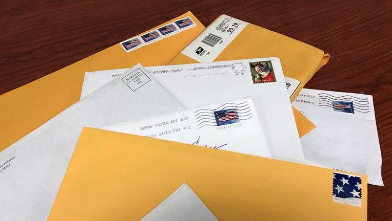 Unopened mail envelopes