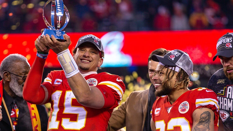Kansas City Chiefs quarterback Patrick Mahomes (15) lifts the championship trophy after winning against the Tennessee Titans at Arrowhead Stadium in Kansas City, Missouri. (Photo by William Purnell/Icon Sportswire via Getty Images)