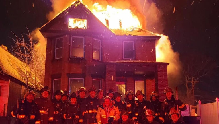 Firefighters in Michigan are in hot water after taking this photo outside a burning house.