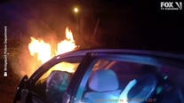 Cops pull woman from burning car in Connecticut