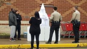 Deputies confront black man wearing KKK robe
