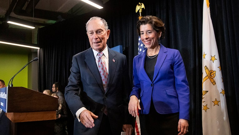 Gina Raimondo and Michael Bloomberg standing next to each other