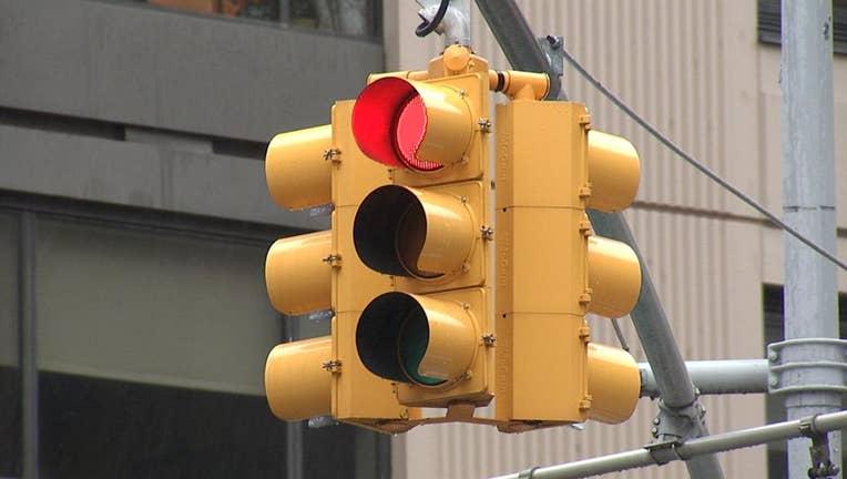 A New York City traffic light shining red