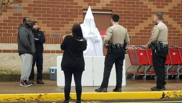 Man in KKK outfit
