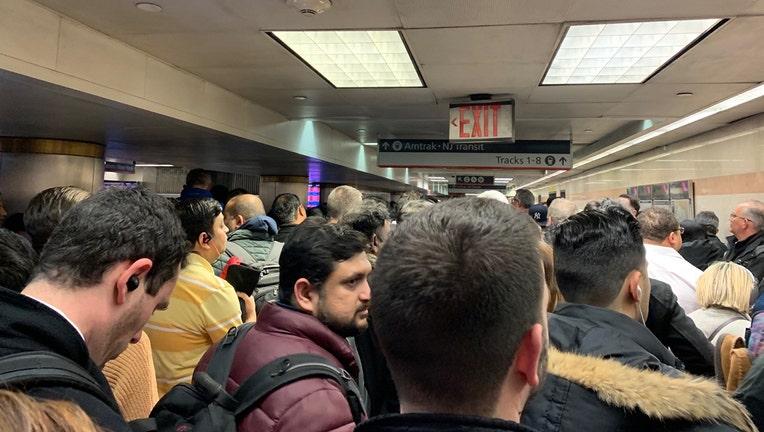 Crowds wait in Penn Station to board New Jersey Transit trains, Feb. 3, 2020.