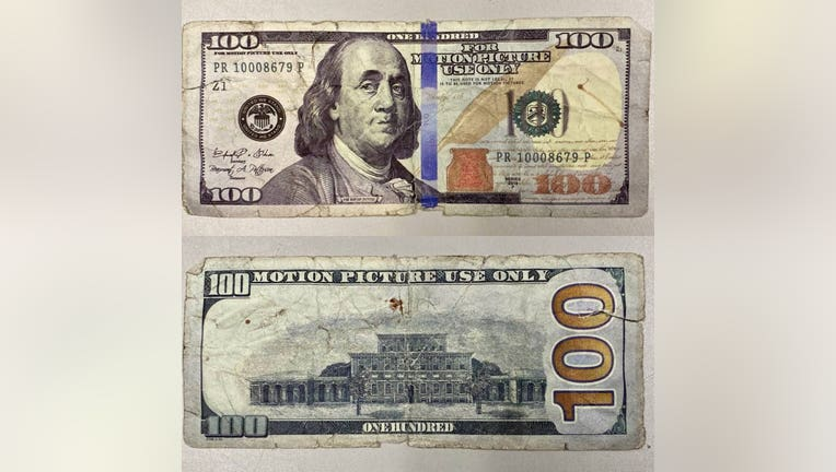 A motion picture prop $100 bill.
