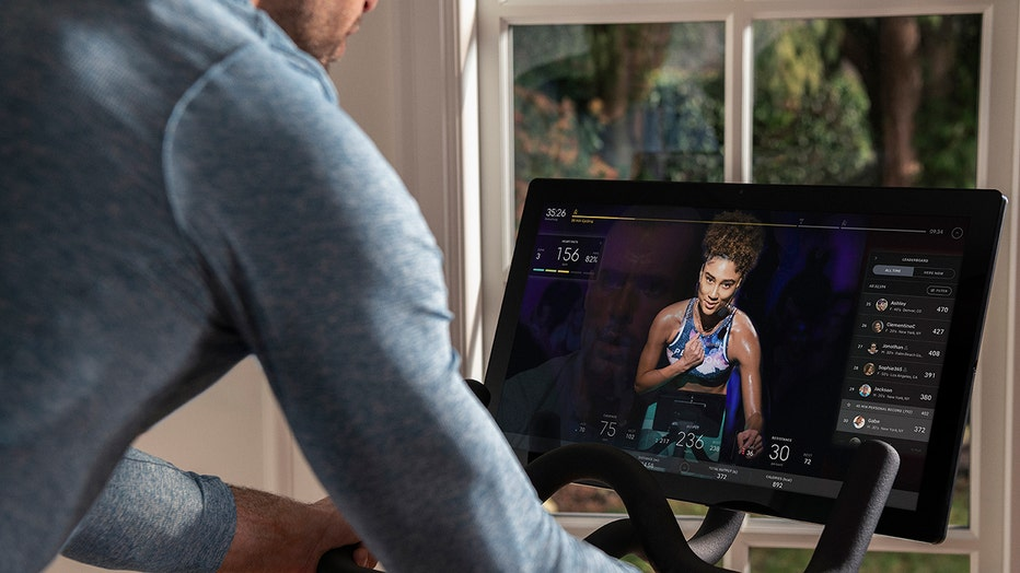 A touchscreen of a Peloton exercise bike