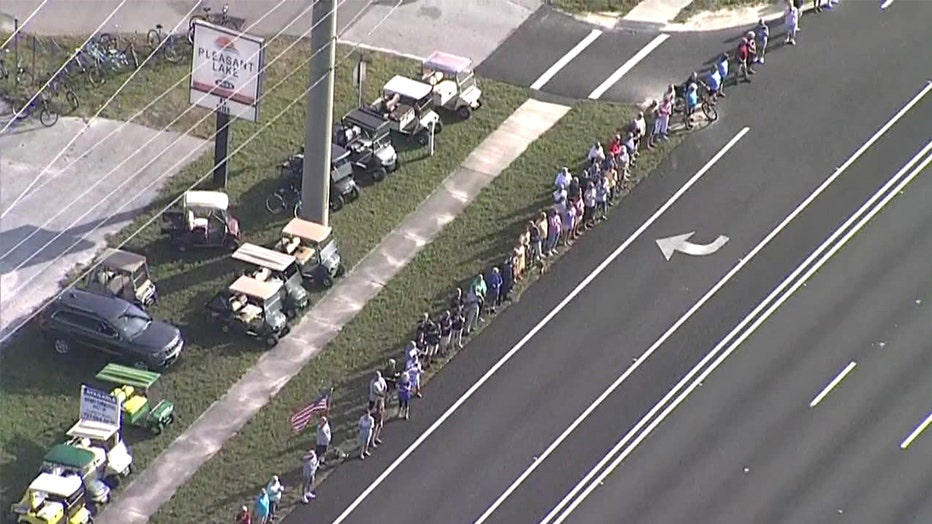 people-lined-up-on-procession-route.jpg