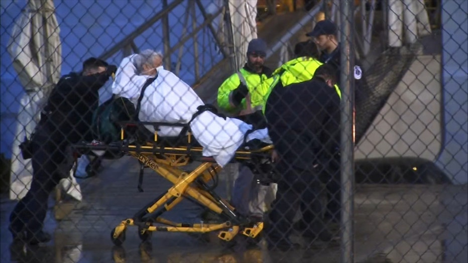 A passenger is taken away from a cruise ship on a stretcher shortly after it docked in New Jersey amid coronavirus fears.
