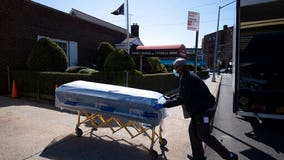 Closed caskets, empty chairs at funeral home in Queens